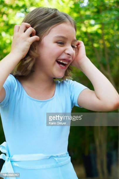 Hispanic girl laughing outdoors