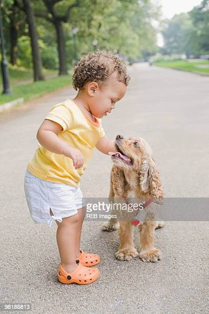 Hispanic girl petting dog