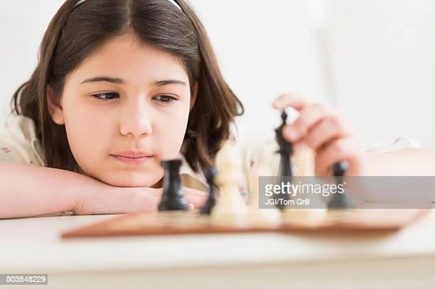 Hispanic girl playing chess