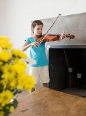 Hispanic girl playing violin