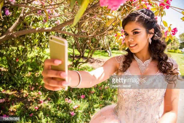Hispanic girl posing for cell phone selfie