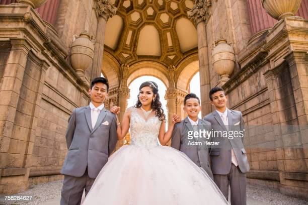 Hispanic girl posing with boys