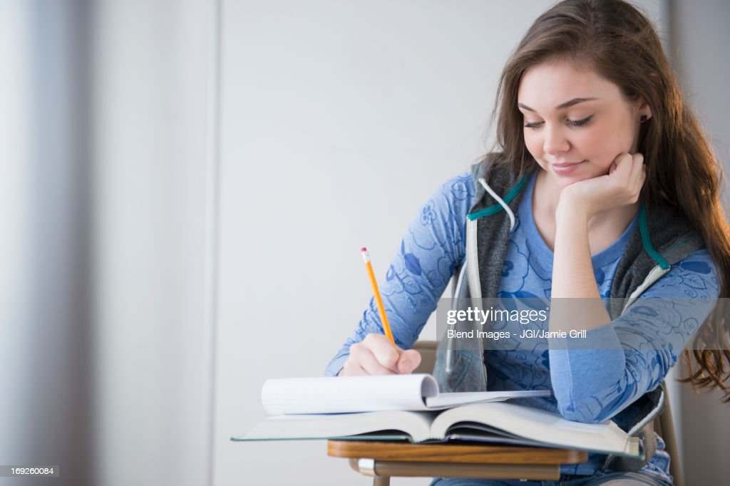Hispanic girl studying at desk