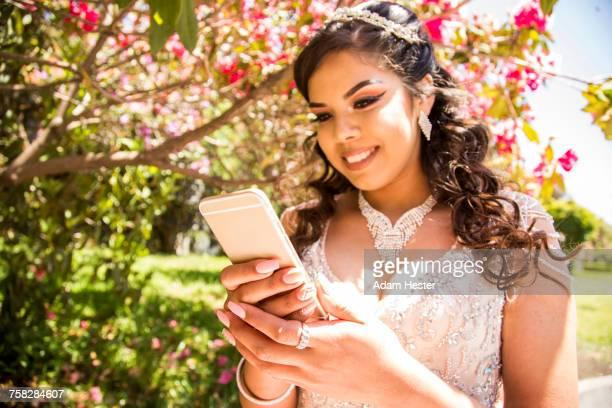 Hispanic girl texting on cell phone
