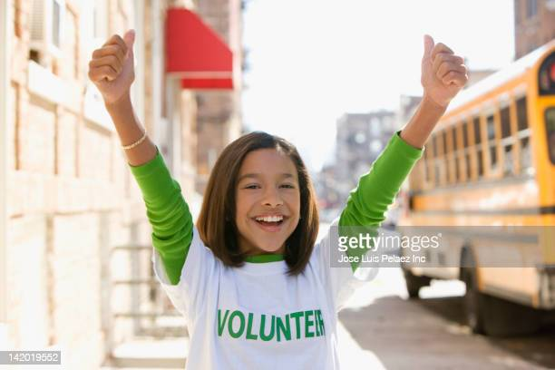 Hispanic girl volunteering and cheering
