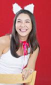 Hispanic girl wearing rabbit ears