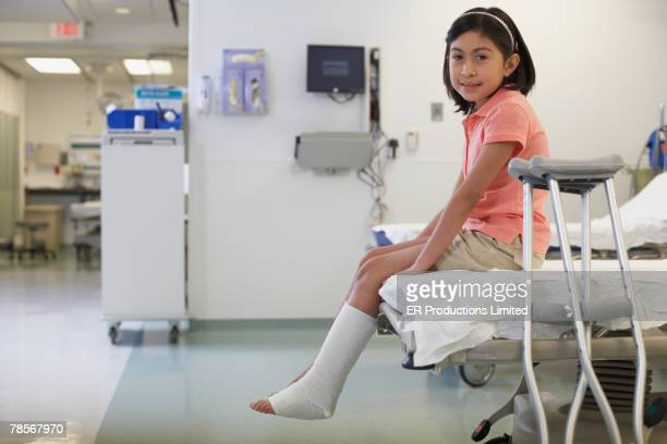 Hispanic girl with cast in hospital