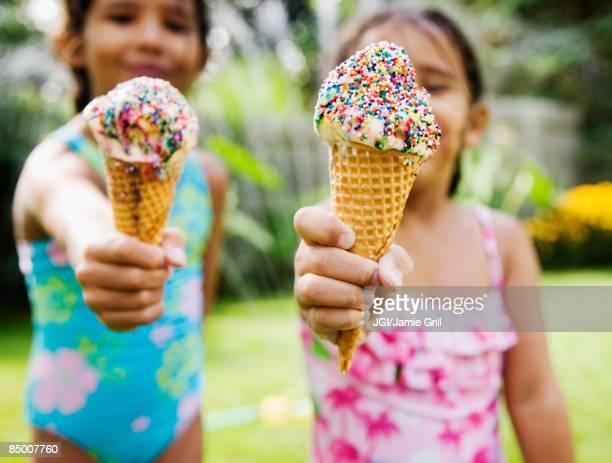 Hispanic girls eating ice cream cones