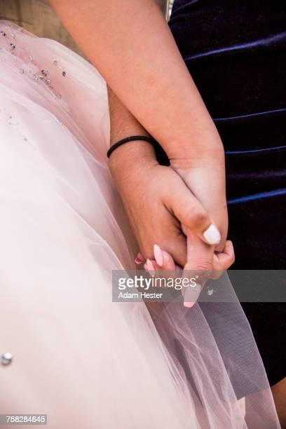 Hispanic girls holding hands