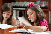 Hispanic girls reading in library
