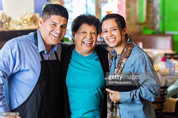 Hispanic grandmother, son and granddaughter in family owned restaurant