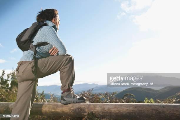 Hispanic hiker overlooking remote landscape