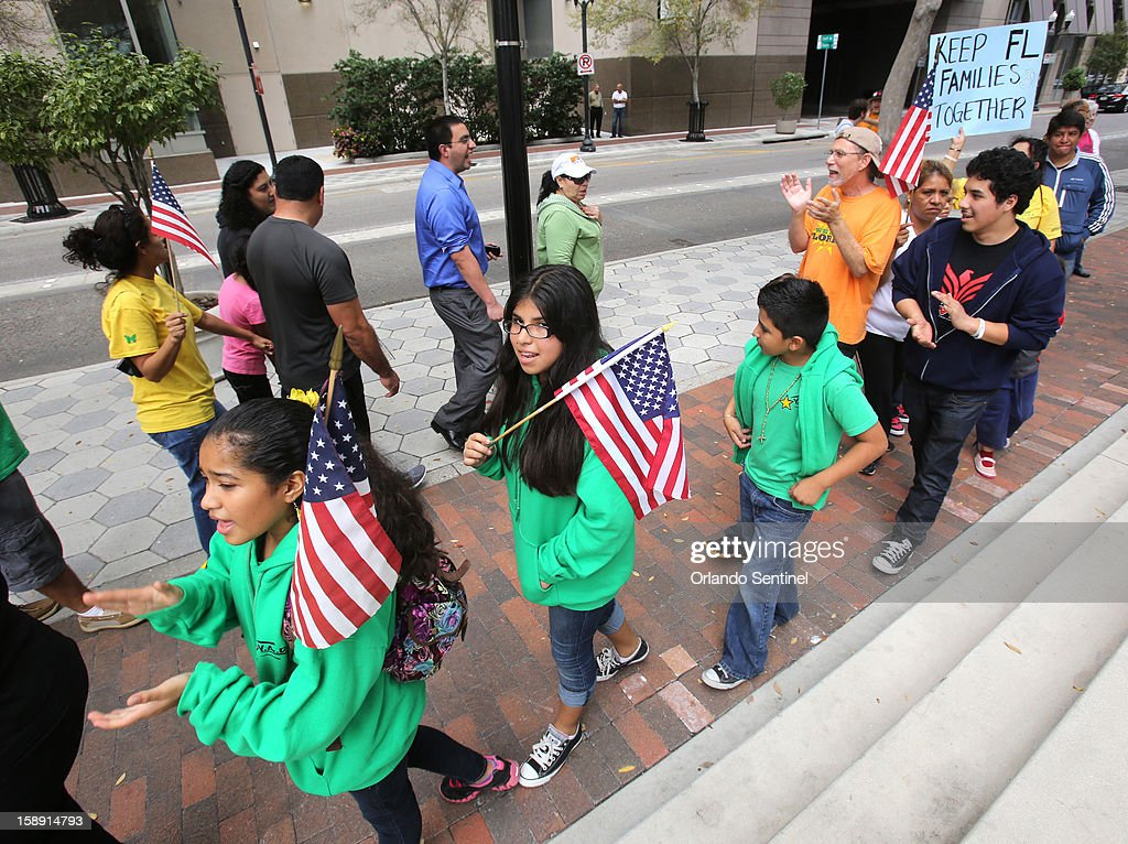 Hispanic immigration policy demonstrators from various groups march outside Sen. Marco Rubio's office in downtown Orlando, Thursday, January 3, 2012.