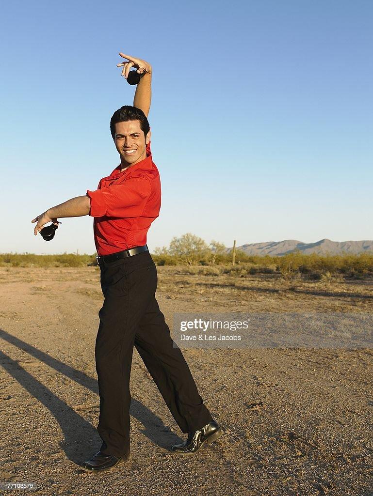 Hispanic male flamenco dancer posing : Stock Photo