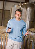 Hispanic male vintner holding glass of wine