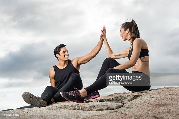 Hispanic Man And Women Resting After Work Out