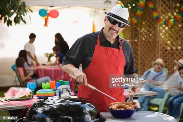 Hispanic man barbecuing