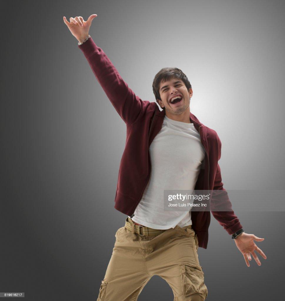Hispanic man cheering
