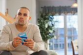 Hispanic man choosing credit cards