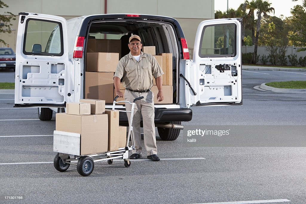 Hispanic man delivering packages