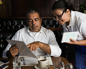 Hispanic man ordering food at diner