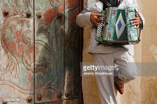 Hispanic man playing accordion