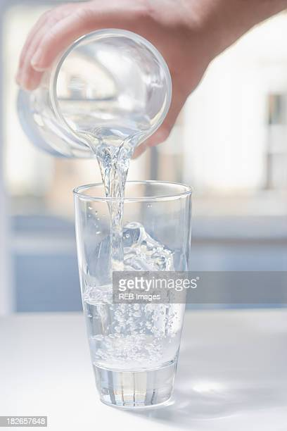 Hispanic man pouring glass of water