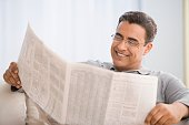 Hispanic man reading newspaper