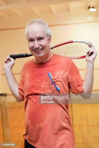 Hispanic man relaxing after racquetball