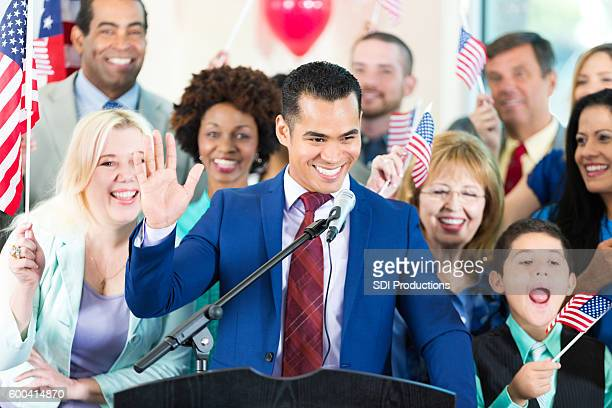 Hispanic man speaking during political rally to support candidate