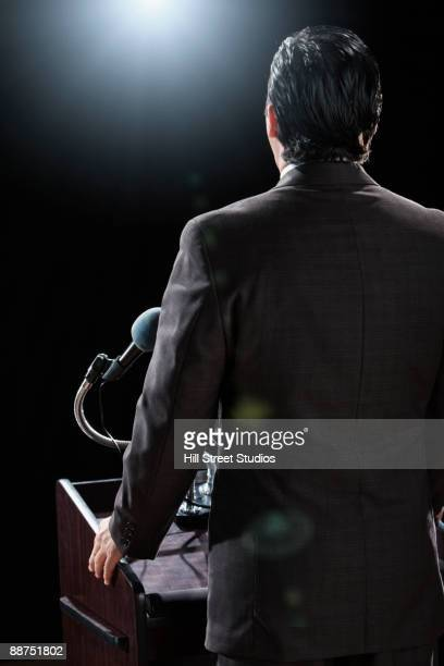 Hispanic man standing at podium