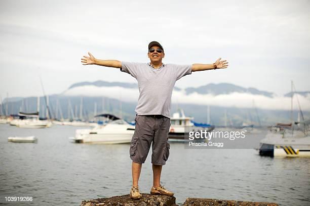 Hispanic man standing at waterfront