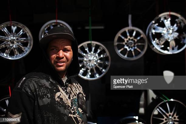 Hispanic man stands in front of an auto repair store he works at on March 28 2011 in Union City New Jersey Union City New Jersey one of the state's...