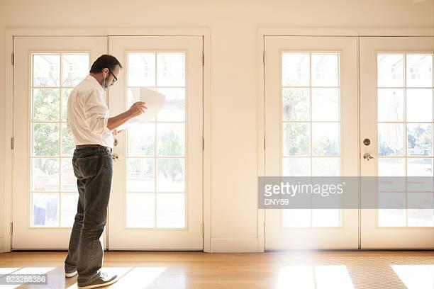 Hispanic Man Talking On Cell Phone Wearing Ear Buds