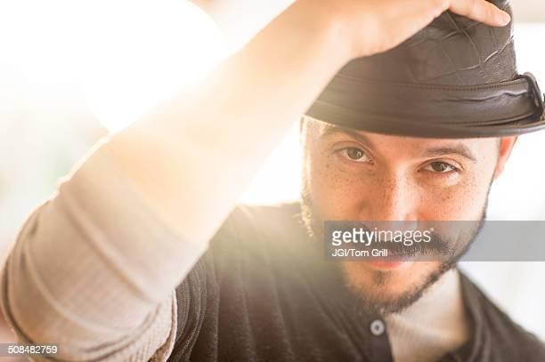 Hispanic man tipping his hat