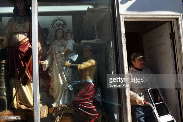 Hispanic man walks out of a store specializing in religious iconography on March 28 2011 in Union City New Jersey Union City New Jersey one of the...