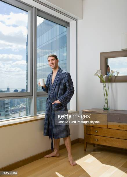 Hispanic man wearing bathrobe