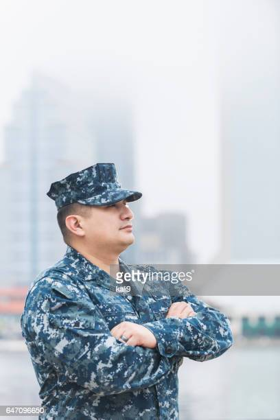 Hispanic man wearing military uniform