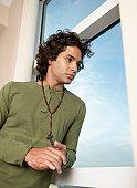 Hispanic man wearing rosary