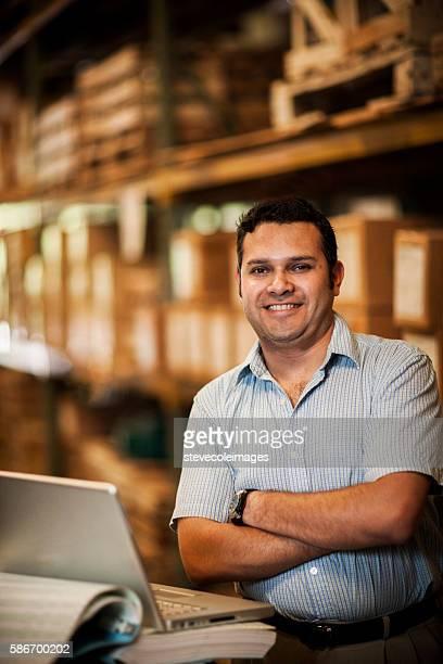 Hispanic Manager in Warehouse