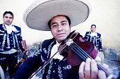 Hispanic mariachi band playing outdoors