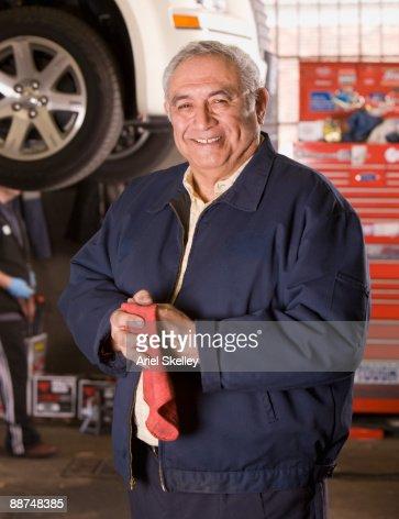 Hispanic mechanic in auto repair shop