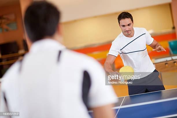 Hispanic men playing ping pong