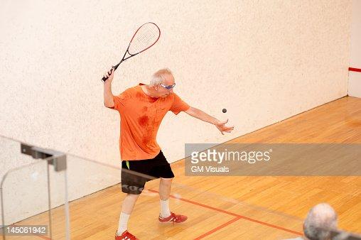 Hispanic men playing racquetball