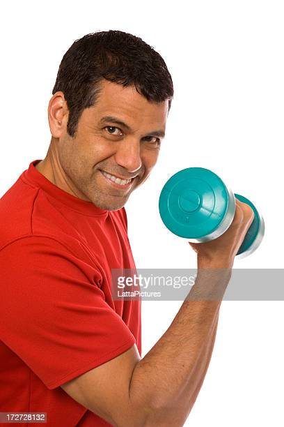 Hispanic mid adult male holding dumbbell bicep curl