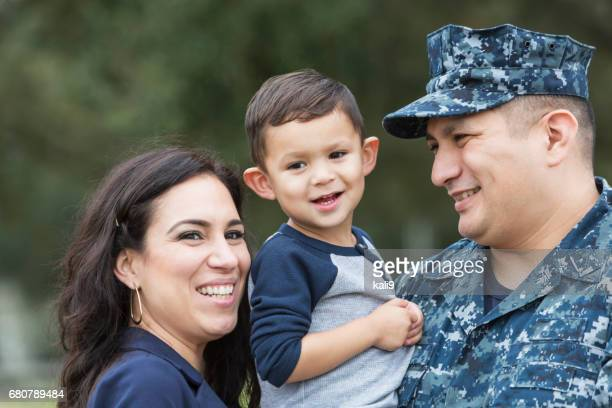 Hispanic military man with little boy and wife