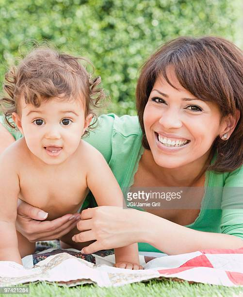 Hispanic mother and daughter in backyard
