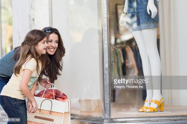Hispanic mother and daughter shopping together