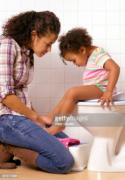 Hispanic mother and daughter toilet training