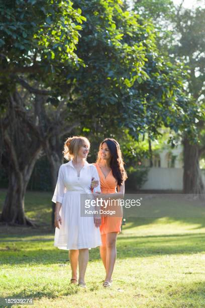 Hispanic mother and daughter walking outdoors